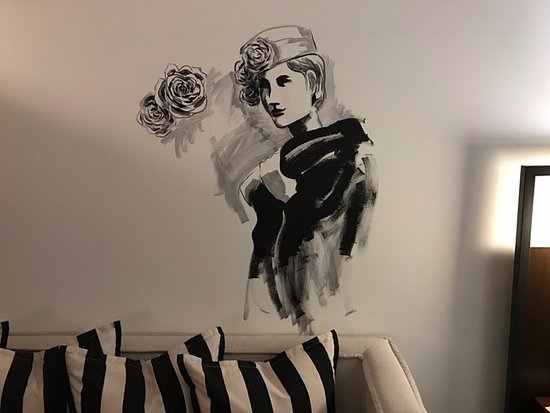 Hand painted wall mural in rooms and in reception updated regularly