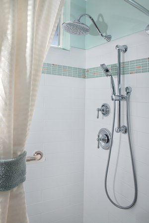 Walk In Showers Feature Overhead And Handheld Shower Heads