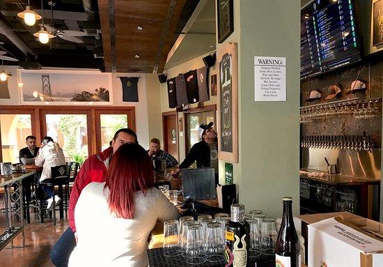 Concord, CA: Casual interior; beer menu on flat screen