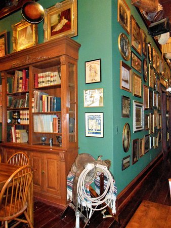 Jefferson, TX: Old photos, books, signs, and paintings line the walls