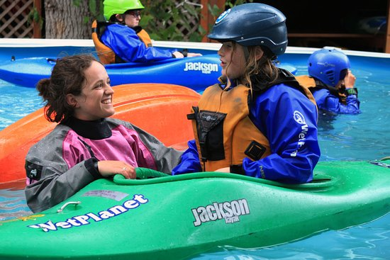 White Salmon, WA: Wet Planet instructor passes on Kayaking stoke to Kids Camp student