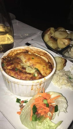 Huge Vegetarian mousaka served with side salad and potatoes and rice! Amazing portions, I split