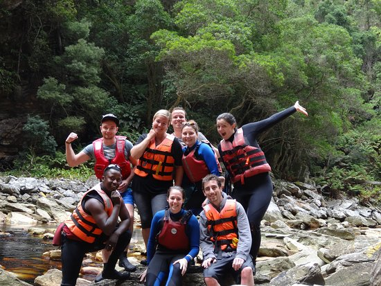 Untouched Adventures: Our group shot with Freddie our tour guide in the gorge after paddling on the lilos