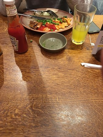 Nando's - Gloucester Road: This is our table. I took the picture about 10 minutes after my friends food arrived, I am still