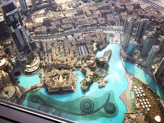 View from the top overlooking the large pool looking area picture of burj khalifa dubai for Burj khalifa swimming pool 76th floor