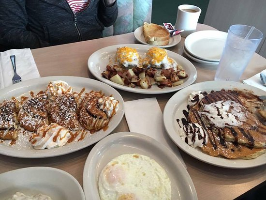 Clinton Township, MI: cinnamon roll french toast, country Benedict, and chocolate chip pancakes.