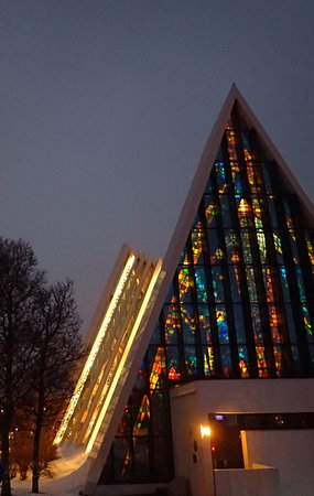 Arctic Cathedral Outside Night View Highlights Stained Glass Window And Unusual Architecture
