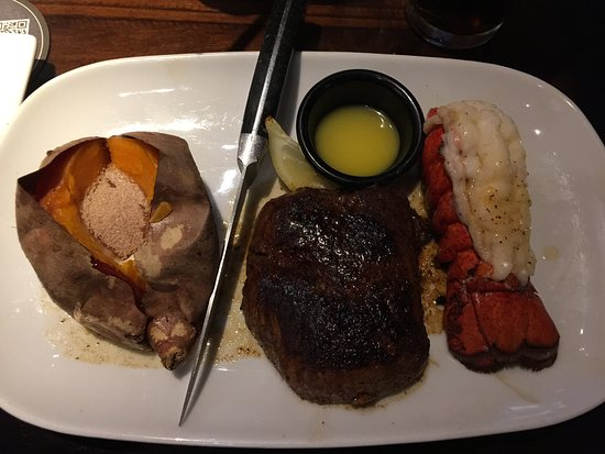 Elmhurst, NY: Steak & Lobster Tail plate, with a wonderful Baked Sweet Potato.