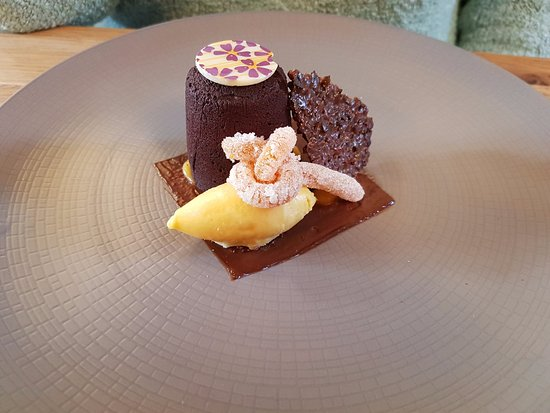 Brill, UK: Freshly cooked warm chocolate pudding with passionfruit and a bitter chocolate snap