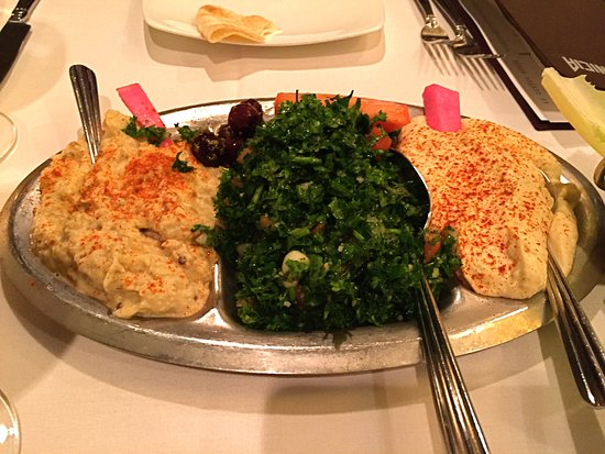 Birmingham, MI: Baba Ganoush, Tabbouleh and Hummus appetizer served with lettuce for wraps