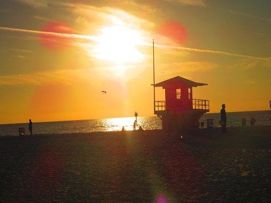 Beach Walk: Sun setting over the lifeguard shack