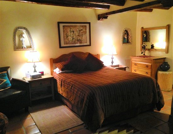Inn at Pueblo Bonito Santa Fe: Foot thick adobe walls, natural wood viga ceiling, authentic southwest décor- Inn at Pueblo Boni