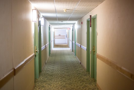 Rhinelander, WI: The hotel was clean overall, but the hall carpets were worn and dated.