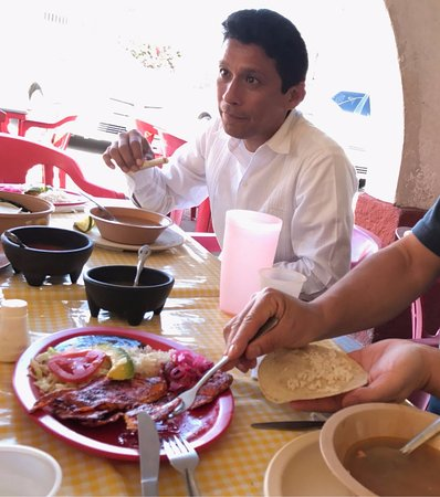 Cancun Deluxe: Miguel explaining maya food