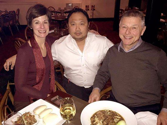 Middletown, CT: My guests, with Mario the Somelier; he offered a wine flight that was well-matched with our meal