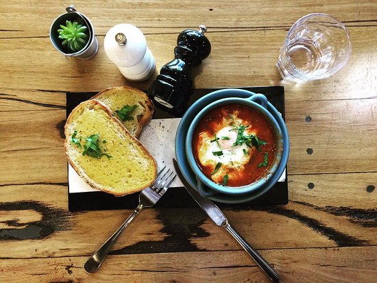 Box Hill, Avustralya: Just Baked Eggs - with slow cooked cannellini beans and chorizo in spicy tomato stew on Sourdoug