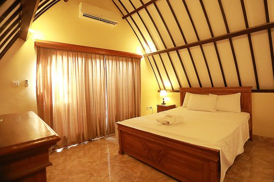 Ozzy Cottages and Bungalows: kamar tidur