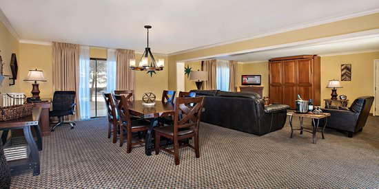 Hotel Elegante Conference & Event Center: Dining Room, Leather Seating Area, and Work Desk available in our Luxury Parlor Suites.