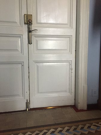 """Hostal Girona: look at the entrance door to our """"upgraded"""" room..."""