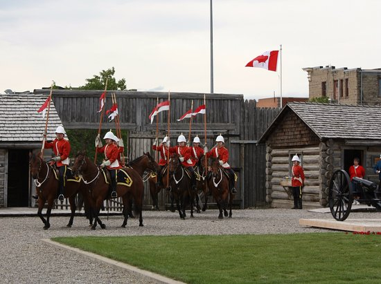 Fort Macleod, Canada: The North West Mounted Patrol entering the compound for inspection