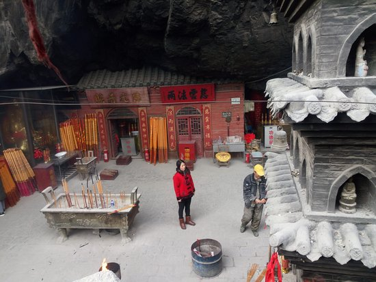 Pulandian, China: Assistance is available for lighting large incense sticks