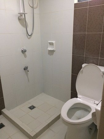 no shower curtain, almost the whole comfort room will get wet when ...