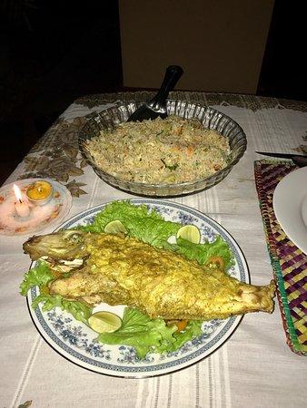 Вид из одного из номеров, и ужин приготовленный хозяйкой.