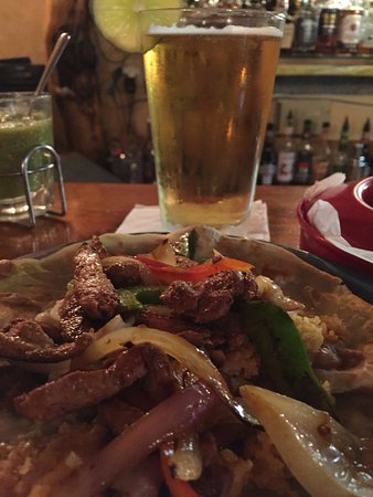 La Pine, OR: Chicken fajitas seasoned perfectly on a homemade tortilla with a Pacifico on draft!