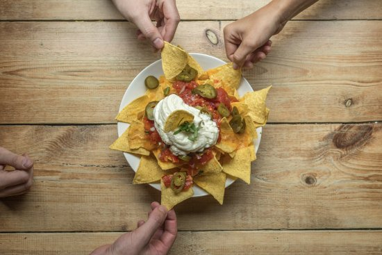 Belushi's: Share a plate of nachos with friends