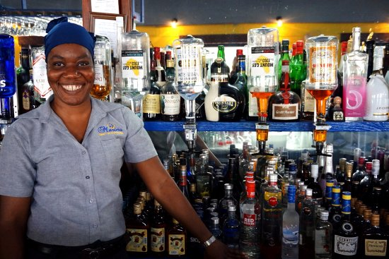 Marina Bar & Restaurant: Checking out the local rums and I got this gorgeous smile with it :)
