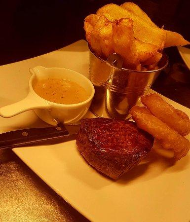 Ballyclare, UK: 8oz. Rump heart steak, chunky chips, onion rings, peppercorn sauce