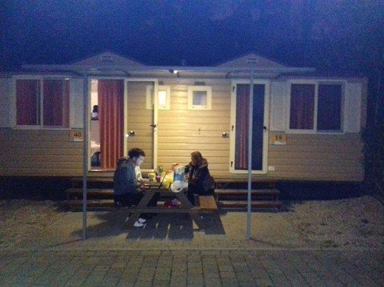 Camping Village Roma: Family having dinner outside of room.