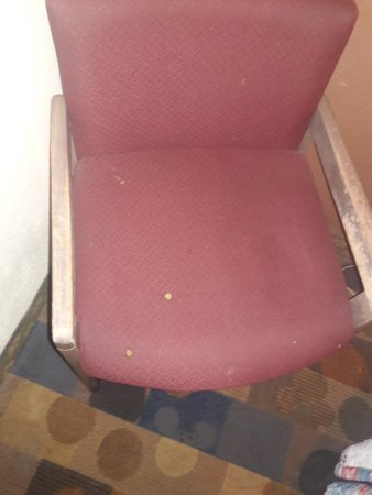 Travel Inn Motel: Cigarette burns on the chair