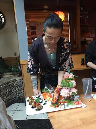 Sushi chef with one of his amazing creations at Sakura in Hermitage, TN