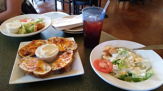 Monroe, WI: Potato Skins topped with cheddar cheese and bacon served with a side of sour cream