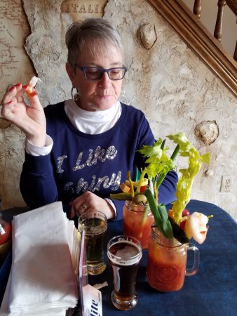 Richfield, WI : My wife enjoying her bloody mary and looking at the menu