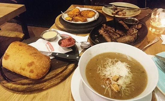 Moshav Ramot: ,home bread. The onion soup slow cooked beef. And New York steak Walden