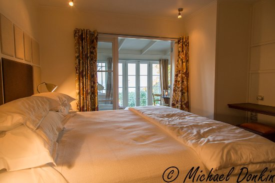 The Boatshed: The bedroom, looking into the sitting room with sea views beyond