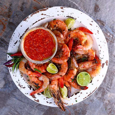 Berea, South Africa: PRAWNS Tiger prawns butterflied & grilled, served with garlic butter, lemon butter and peri-peri