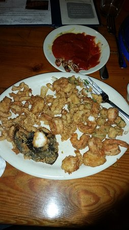 Ladson, SC: The three shrimp tails at the top are from an appetizer. This is the 27 dollar platter.