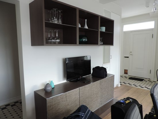 Ambassade Apartments TV In Living Dining Room And Front Door Distance