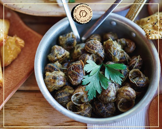 "Kaliviani, Greece: Snails ""Boubouristoi"" on fry pan"