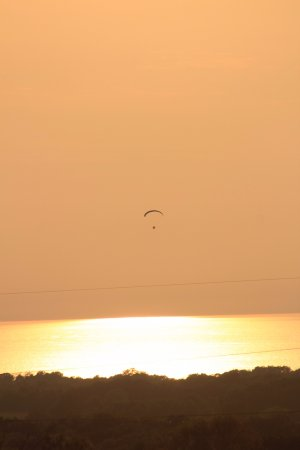 North East, PA: A hangglider. The sun is starting to set.
