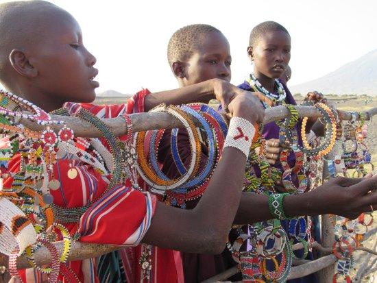 Lake Natron, Tanzania: Maasai girls selling beads at camp fence