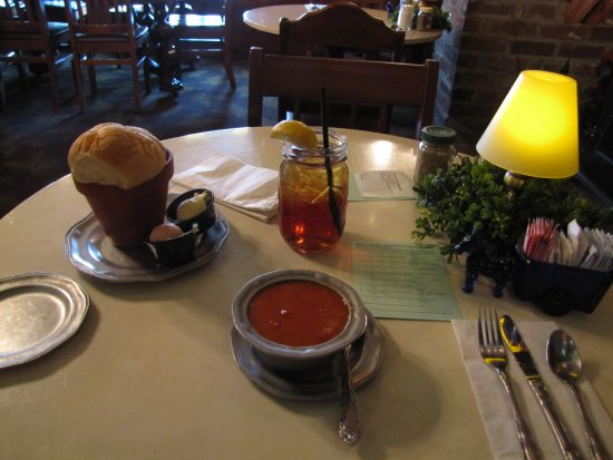 Grand Rivers, KY: The table with tomato soup, bread and sweet tea in jar