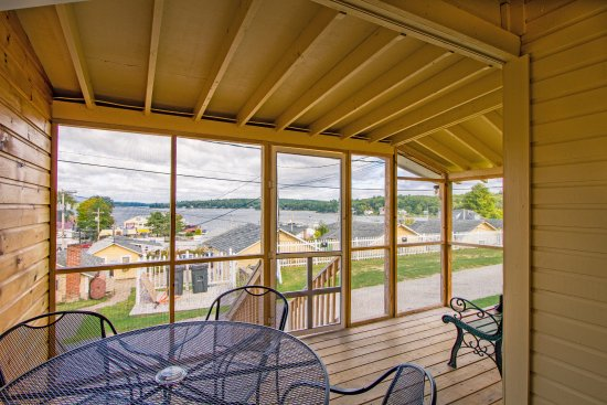 Weirs Beach, NH: The Screened-in Porch of Cottage #C-10