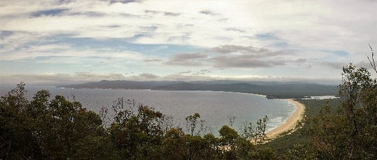 Eden, Australia: Panoramic view over Disaster bay with sea mist approaching