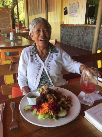 Tilarán, Costa Rica: Mom enjoying the Chicken Roti. Note the generous portion!