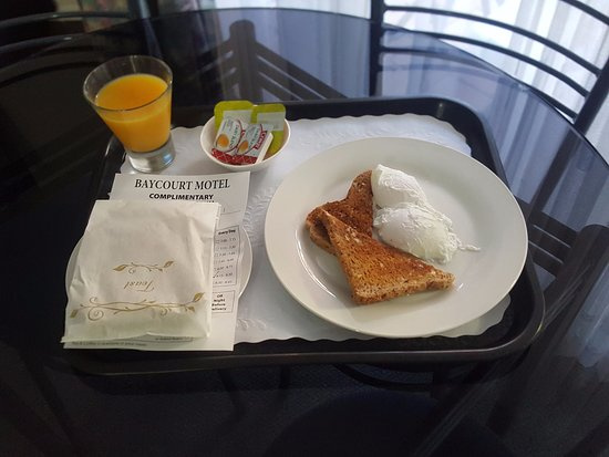 Bay Court Motel: Complimentary breakfast tray... options are either continental or the eggs, poached or scrambled