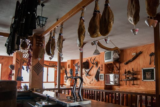 Trevelez, Spania: Famous Trevélez ham curing over the bar